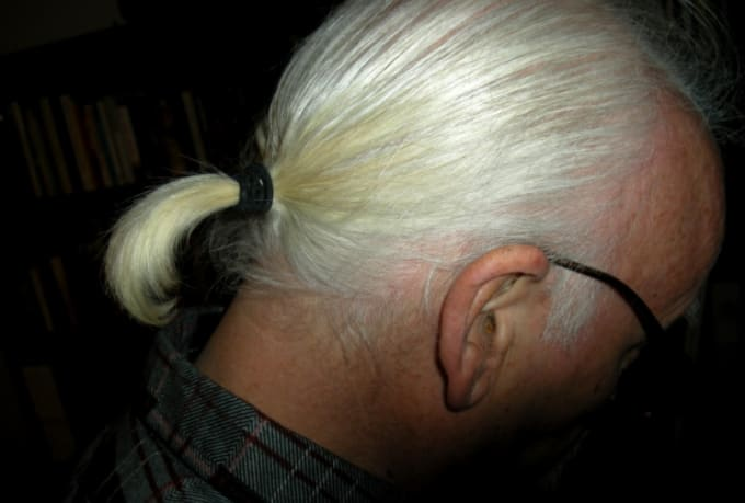 80-greatest-80s-fashion-trends-man-ponytail