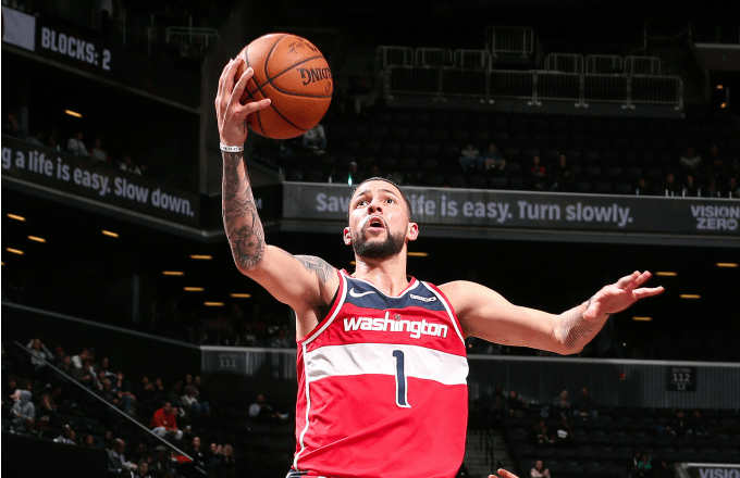Austin Rivers of the Washington Wizards drives to the basket