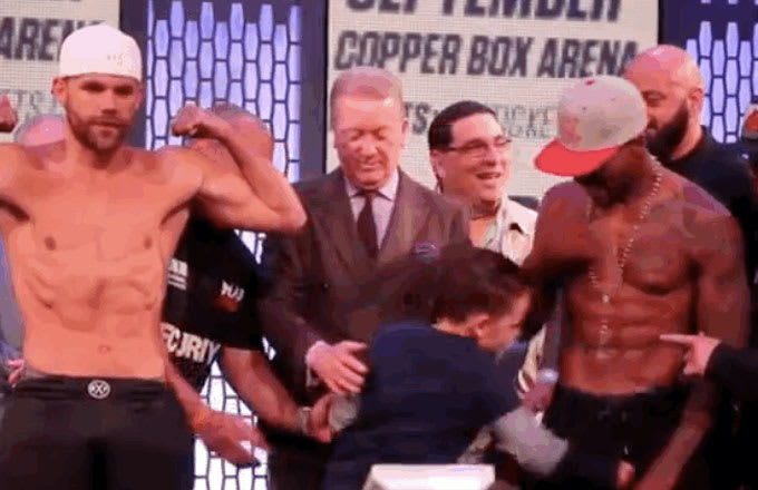 A boxer's son punches his oppoent (Willie Monroe Jr.) in the penis at a weigh-in.