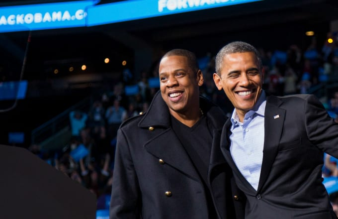 U.S. President Barack Obama stands on stage with rapper Jay-Z