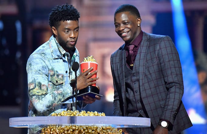 James Shaw Jr. accepts award from Actor Chadwick Boseman.