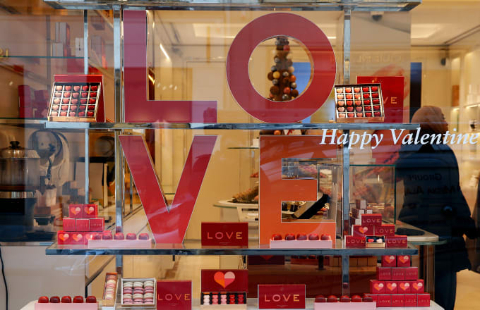 heart-shaped chocolates are seen in the window of a pastry shop