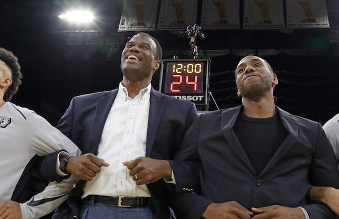 Former Spurs David Robinson joins Kawhi Leonard #2 of the San Antonio Spurs.