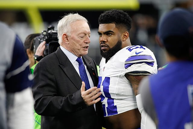 Dallas Cowboys owner Jerry Jones talks with Ezekiel Elliott