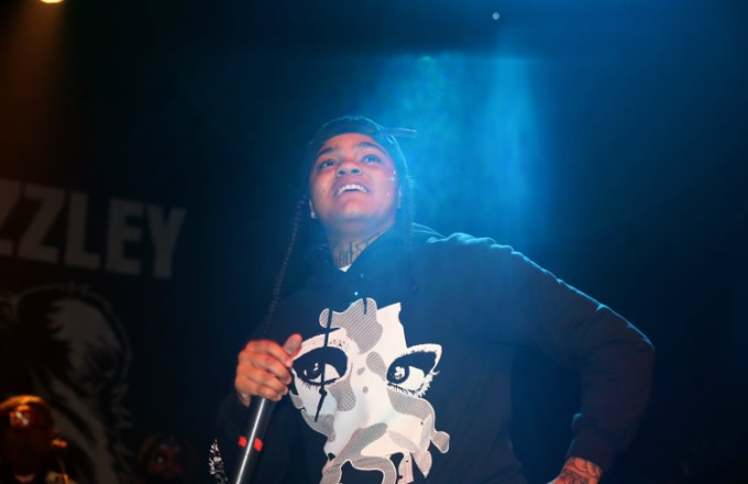 Young M.A performs.