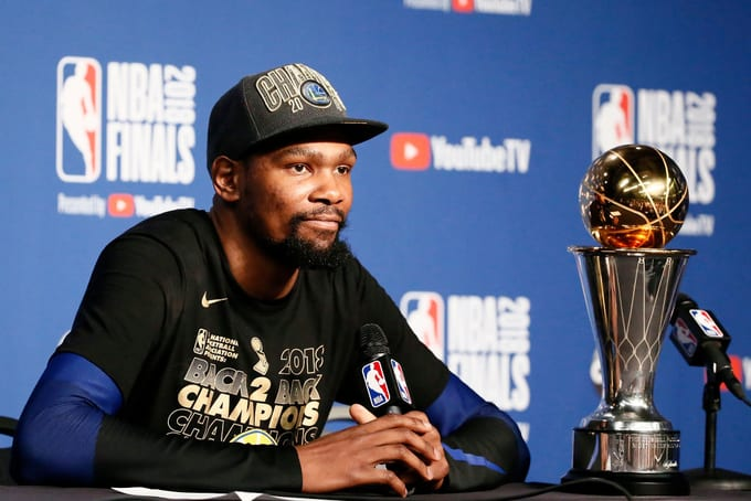 Kevin Durant #35 of the Golden State Warriors talks to the media