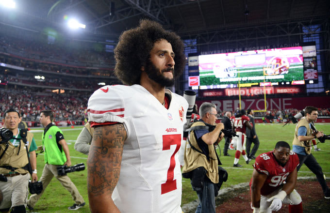 Colin Kaepernick walks off the field after SF's 23-20 loss to Arizona.