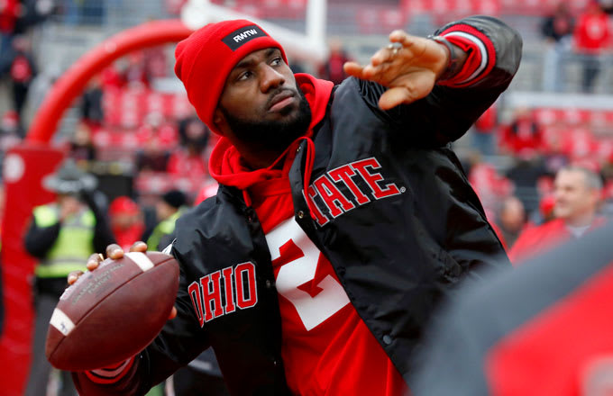 LeBron James chucks a football before the 2016 OSU-Michigan game.