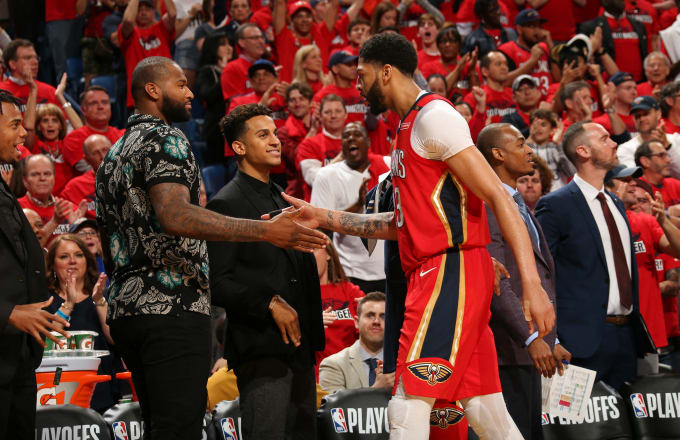 Anthony Davis  23 of the New Orleans Pelicans high-fives DeMarcus Cousins  0 013331922