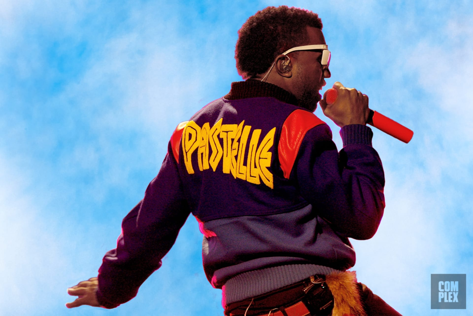 56129d5919dba Kanye West wearing Pastelle varsity jacket