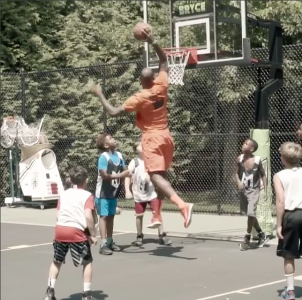 lebron james dunking on little kids