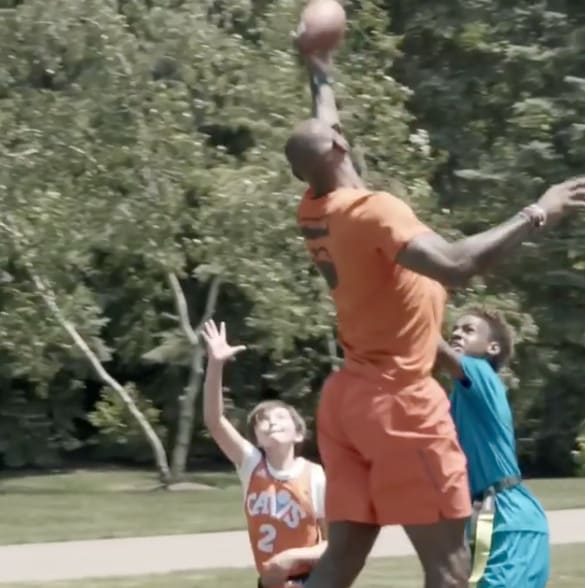 lebron playing football against little kids