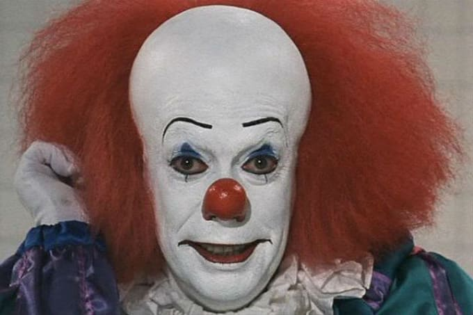 Tim Curry as Pennywise in 'It'
