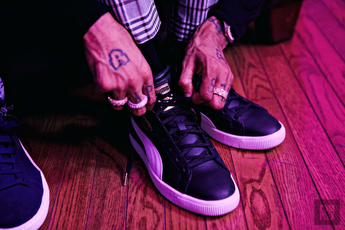 PnB Rock wearing the PUMA Clyde Mid-Foil Sneakers