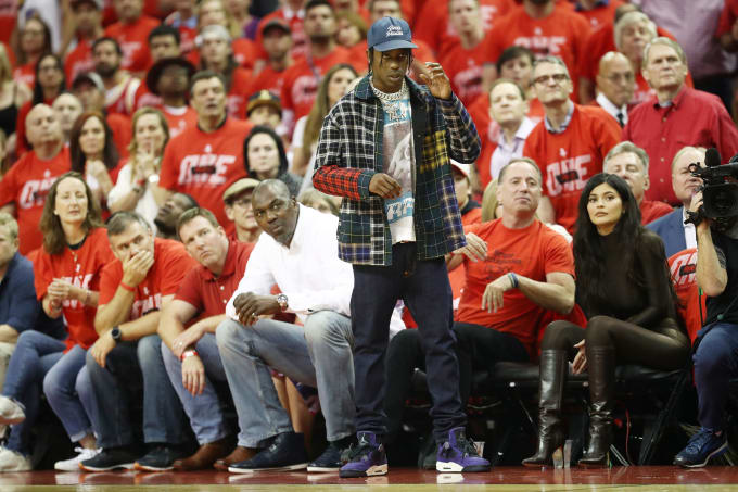 Travis Scott Wears Purple Air Jordan 4