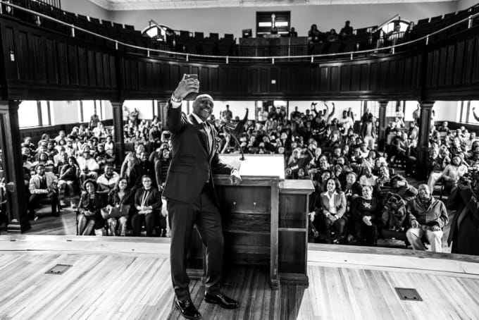 Dave Chappelle taking a selfie with the congregation of Chappelle Memorial A.M.E. Church