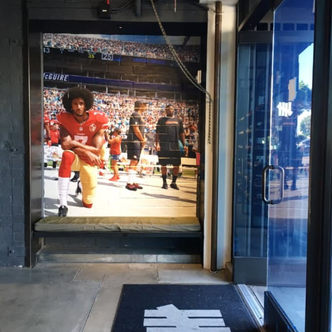 A mural of Colin Kaepernick kneeling during the National Anthem at Undefeated's L.A. store.