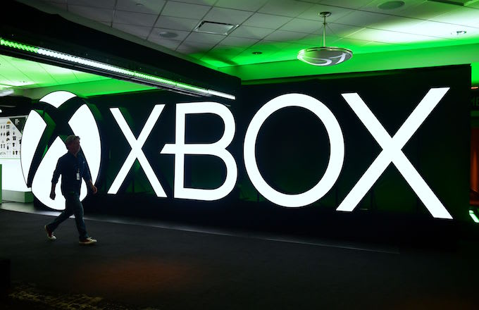 Man walks past an Xbox sign during the Xbox 2018 E3 briefing.