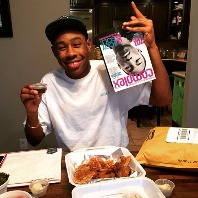 Tyler The Creator Holding An Issue of Complex