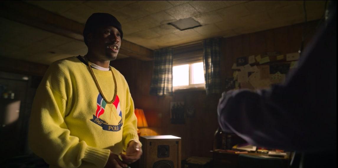 Raekwon Wearing a Polo Cross Flags Sweater In Wu-Tang: An American Saga
