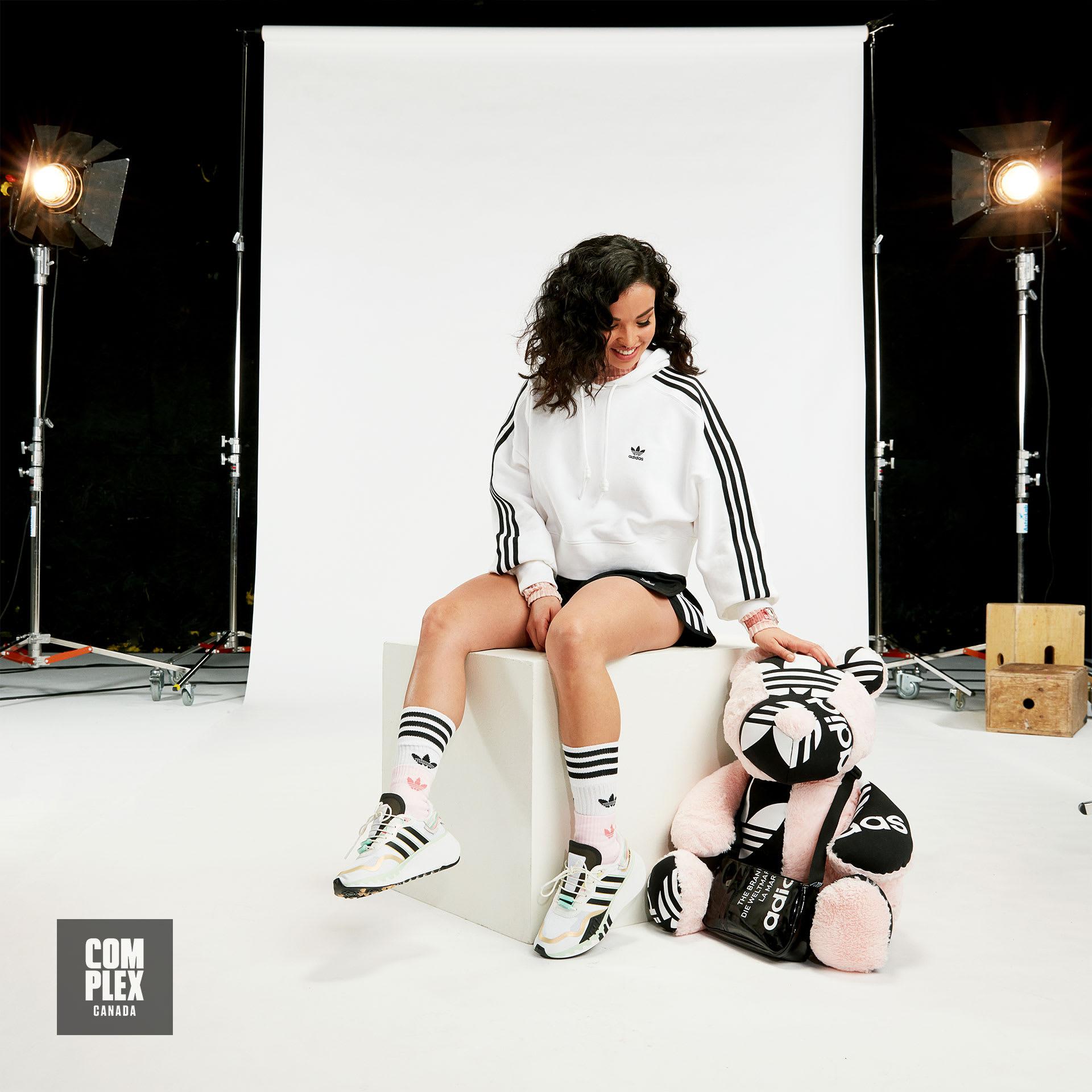 Toronto upcycling artist Natalya Amres poses in adidas RYV
