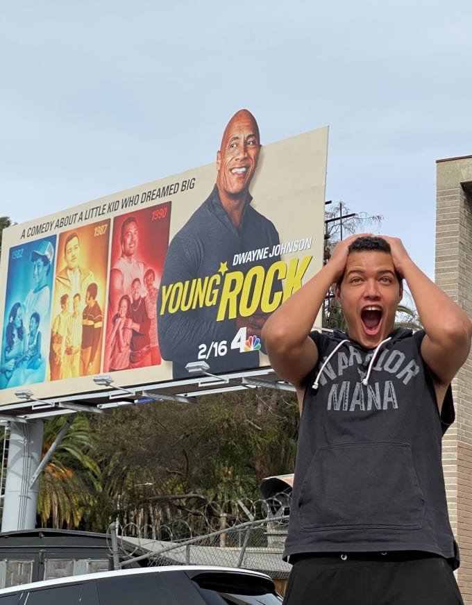 Bradley Constant outside of 'Young Rock' billboard in Hollywood
