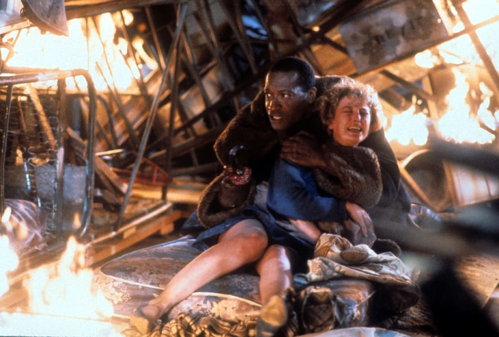 Tony Todd holds onto Virginia Madsen in a scene from the film 'Candyman', 1992.