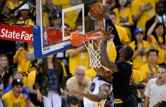 LeBron James blocks Andre Iguodala during Game 7 of the 2016 NBA Finals.